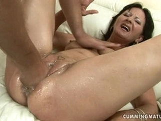 sofa brunette Dirty MILF is stuffed to the wrist in her giant cunt